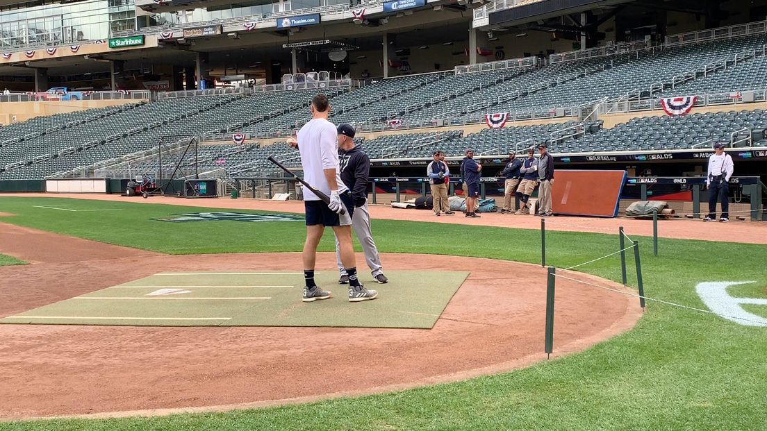 VIDEO: Reggie Willits, the Yankees First Base Coach/Outfield Instructor works with Aaron Judge to show him how the ball reacts off the stone and sign behind home plate at Target Field. Most position players came out to work with the coaches to see the ball bounce off the backstop, which is unique by having that combination of a sign that protrudes a bit and the stone wall.