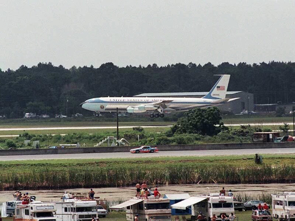 """Today's Daytona 500 POTUS visit has many talking about July 4, 1984, when Ronald Reagan came to the Firecracker 400 and saw Richard Petty's 200th win. This photo still hangs all over Daytona, Air Force One """"racing"""" Petty's No. 43 STP Pontiac as it landed at the airport behind the racetrack."""
