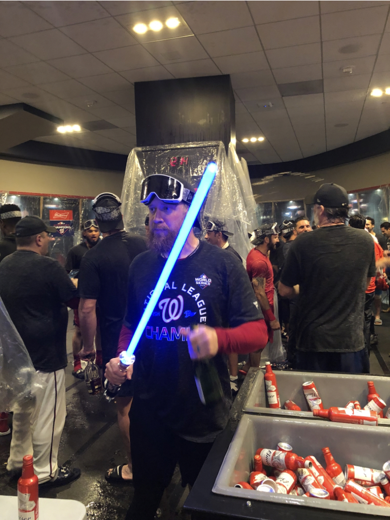 With a lightsaber in one hand and champagne bottle in the other, Sean Doolittle is winning the Nats' NLCS celebration
