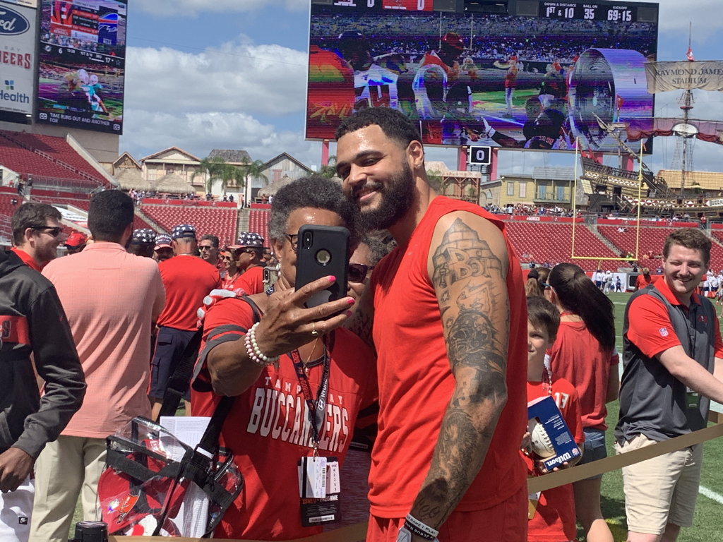 Bucs wide receiver Mike Evans stops for a selfie with a fan after his warmup. He's had a quiet first two weeks, but against a Giants' defense that has allowed an average of 321 passing yards — third-most in the league — today's a prime opportunity.